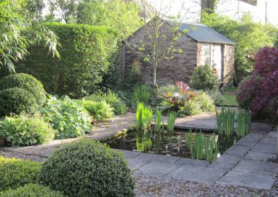A small formal pond and surrounding planting
