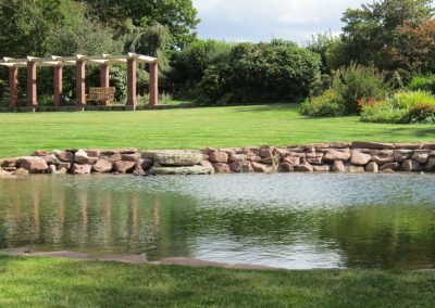 Pergola reflected in the swimming pond