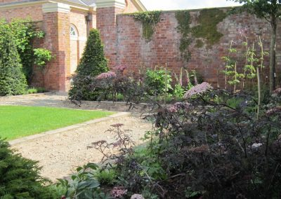 Yew pyramids in the walled garden